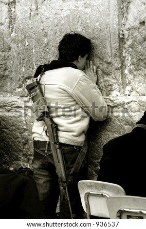 Female settler praying at Wailing Wall, Jerusalem