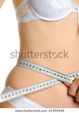 Female shapely a body and a measuring tape. It is isolated on a white background