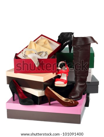 Female shoes and cardboard boxes isolated on white background