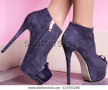 female shoes on a pink background