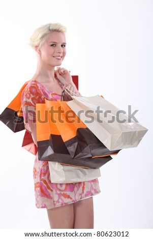 Female shopper and her many bags