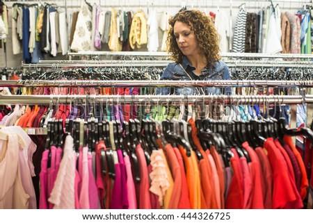 female shopper in thrift store...