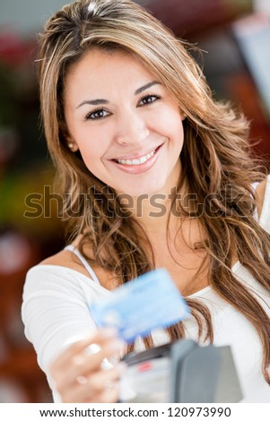 Female shopper paying by credit card at a store