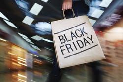 Female shopper visiting mall on Black Friday