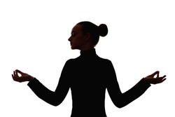 Female silhouette. Meditation practice. Soul healing. Zen nirvana. Dark contrast shadow of peaceful woman enjoying serenity with closed eyes raised hands isolated on white background.