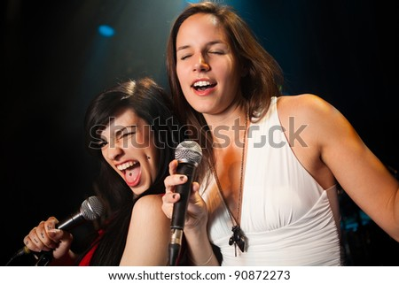 Female singers performing, soft and hard duet