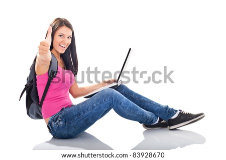 female sitting with her laptop in front of her, agreeing with what she has just seen on the screen, she gives the thumb up hand sign