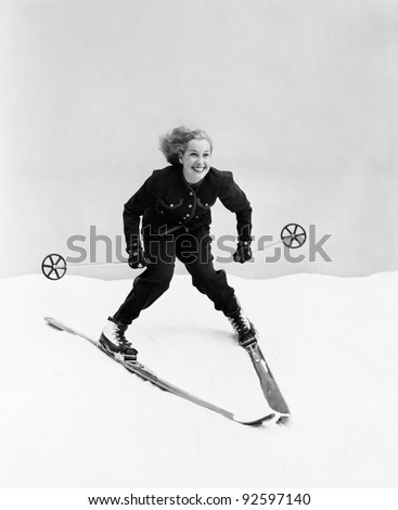 female skier skiing downhill