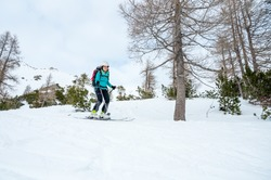 Female skiier enjoying back country skiing in the mountains.