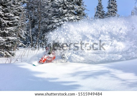 female snowboarder curved and brakes spraying loose deep snow on the freeride slope. downhill with snowboards in fresh snow. freeride world champion. swirls of snow in the air, in a bright mask #1515949484