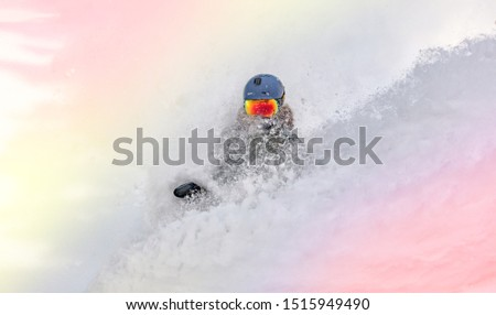 female snowboarder curved and brakes spraying loose deep snow on the freeride slope. downhill with snowboards in fresh snow. freeride world champion. swirls of snow in the air, in a bright mask #1515949490