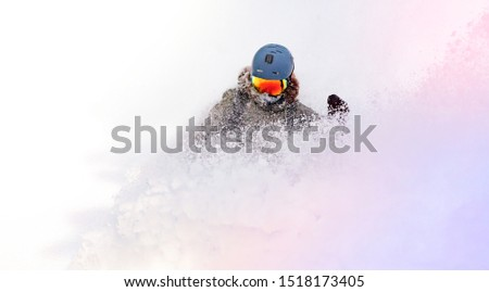 female snowboarder curved and brakes spraying loose deep snow on the freeride slope. downhill with snowboards in fresh snow. freeride world champion. swirls of snow in the air, in a bright mask #1518173405