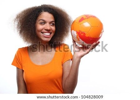 Female soccer fan with a ball