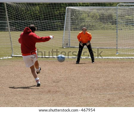 Female soccer keeper prepares for save