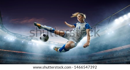 Female Soccer player in action on a professional soccer stadium. Girl playing soccer