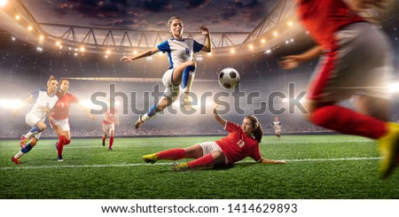 Female Soccer players performs an action play on a professional soccer stadium. Girls playing soccer #1414629893