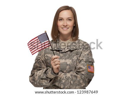 Female soldier holding an American Flag