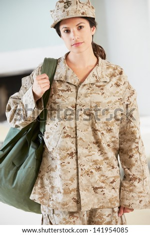 Female Soldier With Kit Bag Home For Leave
