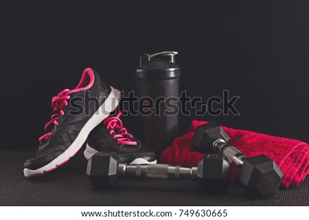 Female sport clothing and equipment copy space. Sneakers, dumbbells, towel and water bottle. Active lifestyle, body care concept