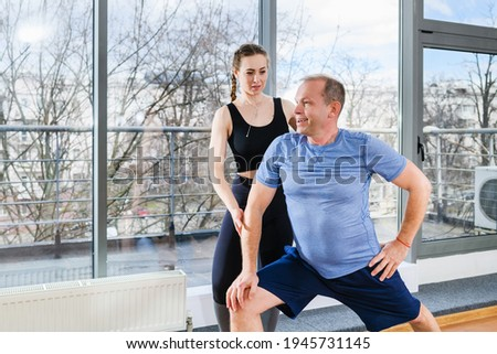 Female sport trainer exercise with mature man Stock photo ©