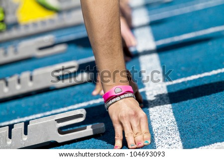 female sprinter waiting for the start