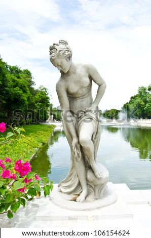 Female  statue made of marble. Decorative gardens of Bang Pa-in Palace, Ayutthaya, Thailand.
