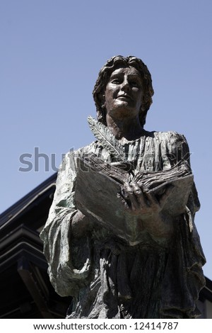 Female Stone Statue: Woman Writing in Book With Feather, Sydney, Australia