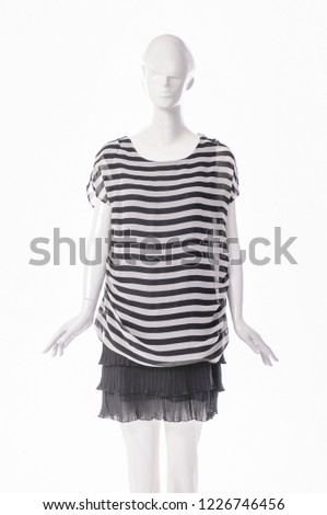 403110f9 Female stripes shirts clothing in black skirt on mannequin isolated-white  background #1226746456