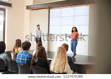 female student giving...
