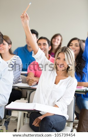 Female student participating in class and raising her hand