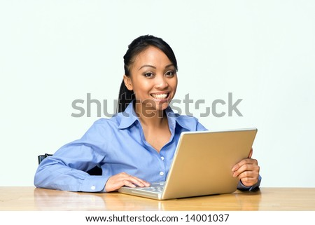 Female student smiles while looking at the camera. Horizontally framed photograph