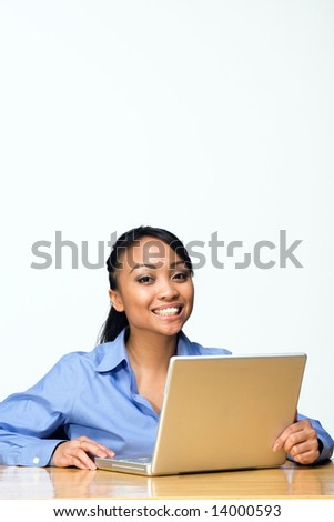 Female student smiles while looking at the camera. Vertically framed photograph