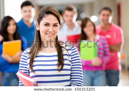 Female student smiling with a group of people at the background