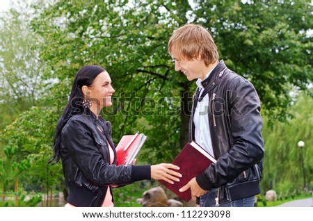Female student talking with friend outdoors