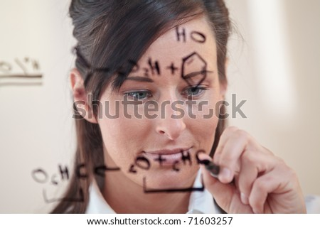 female student works on an equation