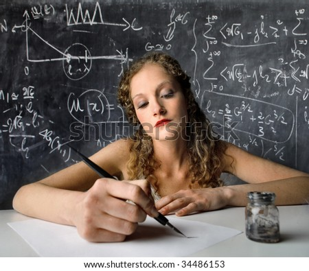 female student writing with ink pen