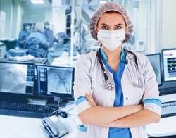 Female surgeon doctor at operation. Interventional cardiology. . Visualization on the monitor in the operating x-ray lab on background