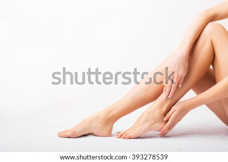 Female taking care of her feet