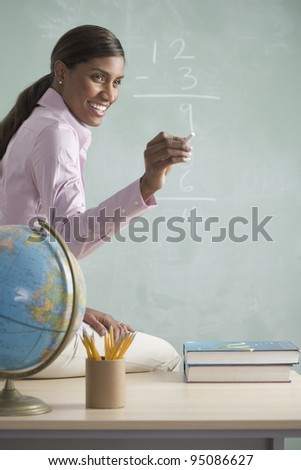 Female teacher at chalkboard