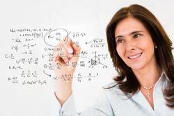 Female teacher wiriting math formulas - education portrait