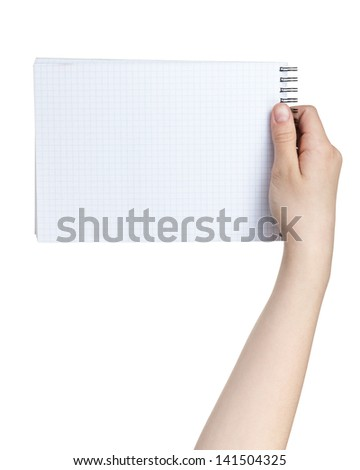 female teen hand holding notebook on a spring to write something, isolated