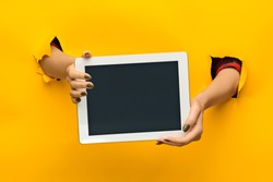female teen hands using tablet pc with black screen, isolated