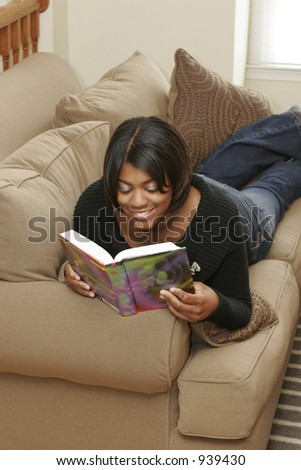 stock photo : female teen on couch reading book