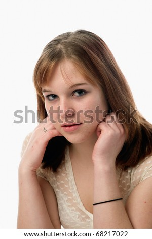 female teen woman with acne problems posing for a portrait