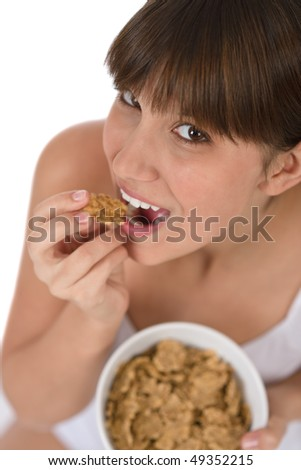Female teenager eat healthy whole wheat cereal for breakfast