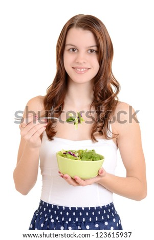 Female teenager eating salad