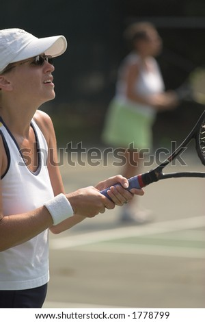 Female tennis player anticipating serve