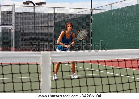 Female Tennis player awaiting a volley