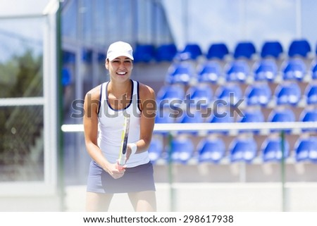 Female tennis player in a receiving service stance