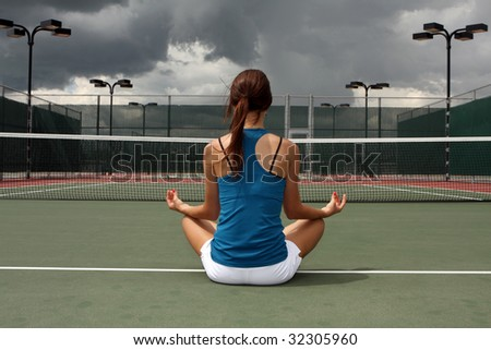 Female Tennis player meditating before the storm